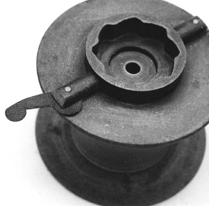 The spool showing the centrifugal tufnol brake.