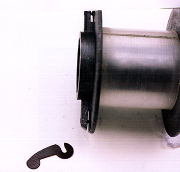 The centrifugal brake and the slot on the spool.