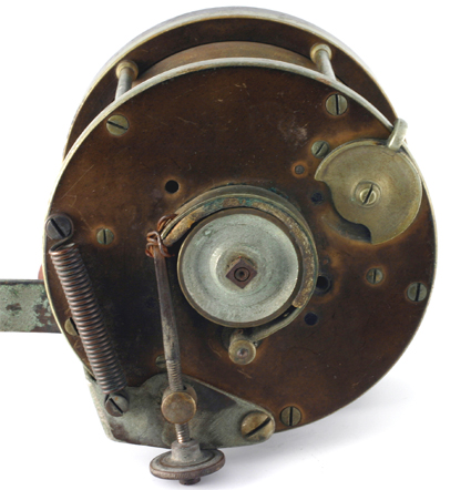 The back plate of the reel showing the screw tension adjuster brake pad and brass lined wheel.