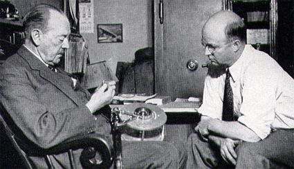 Mitchell-Henry left explaining the workings of his reel to Harlan Major